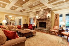 coffered ceiling and stone fireplace