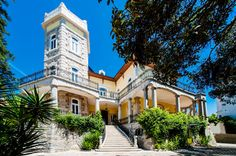 Fourteen miles east of the Portuguese capital, a fanciful five-bedroom, stone-covered house dating from 1899 combines the elegant and the rustic. Luxor, Lisbon, Ny Times, Palace, Coastal, Home And Family, Real Estate, Romantic, Rustic
