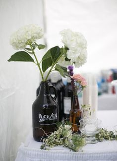 We've all seen wine bottles used as adding decoration, but for the beer aficionados out there, show off your gorgeous blooms in an empty growler for a bit of a personalized flair. Photo credit: Jean Loper Photography