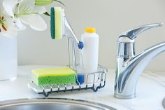 Organise your sink with the sink top caddy ($12.95). It holds a brush, soap and sponge and also has a drip tray. Available at Howards Storage World