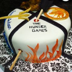 Percy Jackson, The Hunger Games, Divergent, and, is that a sorting hat on the other section? GEEK CAKE!!