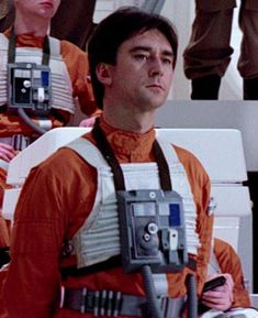 Denis Lawson as Wedge Antilles. The only minor character to appear in all three of the original Star Wars Trilogy. (Also he is the uncle of Ewan McGregor - Obi Wan Kenobi in the prequels)
