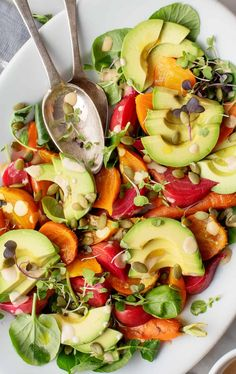 This healthy avocado salad recipe is one of my favorite things to make with avocado. It's filled with colorful roasted veggies, avocado, pepitas, and a nutty tahini dressing. Vegan and gluten-free. Side Dish Recipes, Side Dishes, Guacamole, Roasted Beets And Carrots, Avocado Salad Recipes, Asparagus Soup, Root Veggies, Brunch, A Food