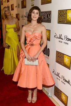 Lizzy Caplan in a retro-inspired, peach, strapless dress