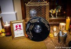 Photo of: indian wedding reception decor gold table setting candles | MaharaniWeddings.com