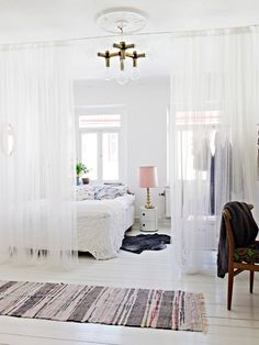 Sheer white room dividing curtains (on a ceiling mounted track?)