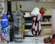 STRAWBERRY MUDSLIDE 3/4 oz. (22ml) Vanilla Vodka 3/4 oz. (22ml) Baileys Irish Cream 3/4 oz. (22ml) Kahlua Vanilla Ice Cream Chocolate Syrup Strawberries