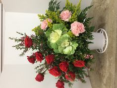 Nina rose, kale, light pink carnations, solidago, buronia & greenery by Donna Jeffries