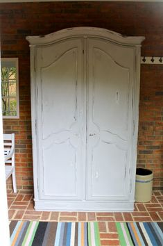 Armoire painted with Annie Sloan Chalk Paint.  Old White and top coat of Paris Grey.