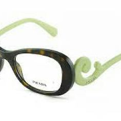 Prada Eyeglasses Prada Eyeglasses. New and Authentic  Brown and green frame. Size 54-19-135  Includes original Prada case Prada Accessories Glasses