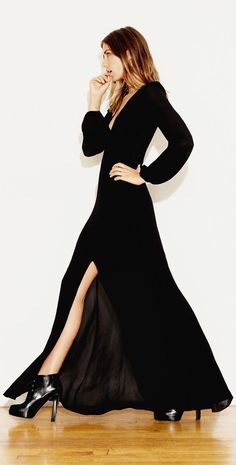 Long sleeves, a flowing skirt, and a thigh-high slit make this black dress a major statement. So Angelina.