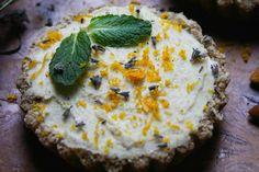 Raw vegan lemon tart with lavender and mint garnish and a gluten free buckwheat groat and almond crust