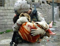 Some wounds can't be seen, and will never heal: A US soldier weeps in anguish as a young Iraqi girl dies in his arms.