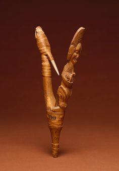 Tlingit artist   Fishhook, about 1800   Wood, bone, spruce root   Alaska, Pacific Northwest Coast, United States   This V-shaped fishhook is comprised of two wooden arms lashed together; a bone barb is attached to one, and the fisherman's spirit helpers are on the other. On this hook, a human, with a spiny sculpin (fish) on his head, stands on top of a sea creature. Native American Beauty, Native American Indians, Native Americans, Tlingit, Indigenous Art, Fish Art, Native Art, First Nations, Tribal Art