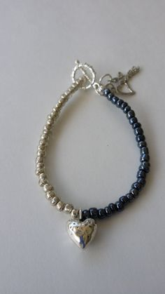 Hey, I found this really awesome Etsy listing at https://www.etsy.com/listing/228870739/silver-and-blue-beaded-bracelet