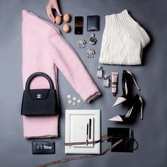 fall flat lay from Instagram - plaid sweater, black patent leather boots, nars makeup, prada