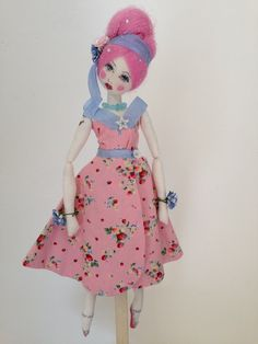 Blackbird Secrets.  Lovingly handmade dolls using carefully sourced vintage fabric with hand painted faces.