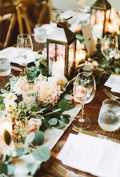 Brides.com: . Lanterns are a charming way to light up a country chic table setting and really let those garlands of eucalyptus and jasmine vines shine.