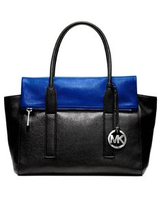"MICHAEL Michael Kors Tippi Large Satchel, Sapphire. Silver-tone hardware. Python print exterior. Logo plaque at front. Double top handles with 6"" drop. Magnetic closure with front zip pocket, 2 side slip pockets, and signature logo charm. Inside features 'MK' logo lining, one zip and four open pockets."
