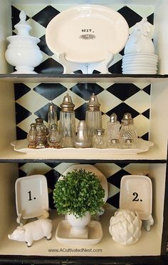 "Pretty details in this vignette. Black and white themed china cabinet - white typography and numbered accessories. Love the little ""Nest"" plate! Small China Cabinet, China Cabinet Decor, White China Cabinets, Mantel Styling, Bookcase Styling, China Display, Hutch Display, Display Cabinets, Armoire"