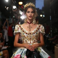 Portraying the persona adorned in gold and ruby with purity spirit. Dolce&Gabbana Alta Moda. #DGLovesNaples photo by @fashiontomax @rorphoto