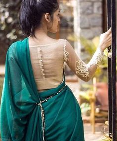 Latest Blouse Back Neck Designs - Buy lehenga choli online Blouse Back Neck Designs, Netted Blouse Designs, Indian Blouse Designs, Sari Design, Saree Blouse Patterns, Designer Blouse Patterns, Pattern Blouses For Sarees, Lehenga Blouse, Lehenga Choli