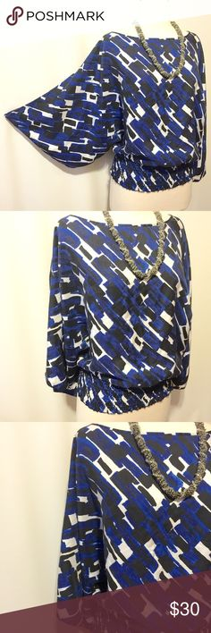 """Michael Kors Blue & Black Printed Silk Blouse Silk blouse in a graphic blue, black and white print. Over sized fit. Batwing sleeves, 4"""" elastic smocked hem. 100% silk Machine washable 52"""" bust 24""""overall length MICHAEL Michael Kors Tops Blouses"""