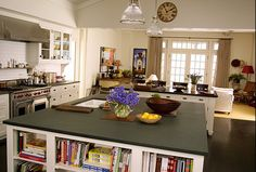More space for books and a blackened wood flooring...