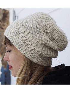 "This fun-to-stitch hat features different stitches to keep you interested, yet it's quick to make and not at all complicated. Knit with approximately 170 yds of #3 DK-weight yarn at a gauge of 19 1/2 sts and 26 rows per 4"" using a U.S. size 5/3...."