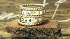 Sterling silver stacking rings, stamped, and with hand cut 3mm solid 14k rose and yellow gold hearts