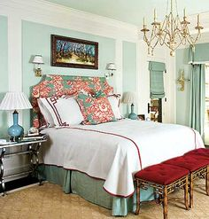New American: Red, White, and Aqua . The pale blue hue of this bedroom pops against the bold red of the headboard and the stools at the foot of the bed.