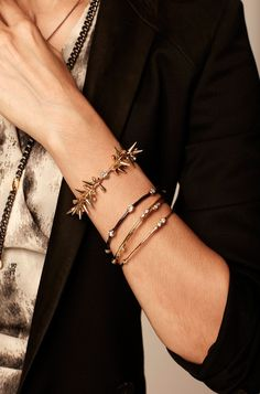 Gold plated spikes and black diamond Pavé beads adorn this bracelet. Mix match and stack it with other bracelets to create your favorite combination.