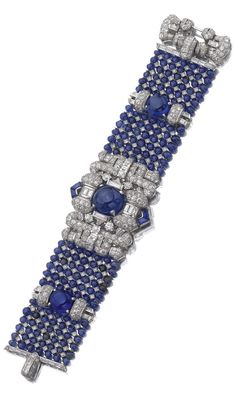 An Art Deco sapphire and diamond bracelet, 1930s. The central panel highlighted with a round cabochon sapphire set within a surround of baguette and circular-cut diamonds and calibré-cut sapphires, continuing to a mesh of sapphire beads and single-cut stones, accented with arched diamond set motifs and two cabochon sapphires. #ArtDeco #bracelet #braceletdiamonds