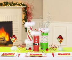 LOVE the centerpiece!  (Use Pringles Cans)  Christmas Decor for kids table! cute!
