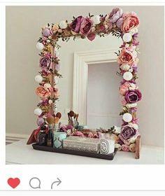 Diy. Hot glue fuax flowers to a cheap mirror.