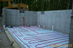 This is what I call... the way to go! In slab heating; hot water or glycol circulating in a pipe evenly distributing heat in the whole space.