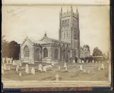 Anonymous | Exterieur van de kerk van St. Andreas met een kerkhof ervoor in Mells, Anonymous, c. 1860 - c. 1870 | Onderdeel van Engels familiealbum met foto's van personen, reizen, cricket en kunstwerken.