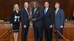 Edward Waters College president Nat Glover was recognized Tuesday with the Great Floridian award for his dedication to higher education and the community of Jacksonville.