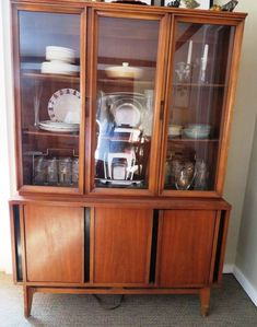 Mid-century modern pecan hutch with 6 panels and black accents, 2 glass doors on top and 2 wood doors on bottom. Lovely representation of this period. Modern China Cabinet, Pecan Wood, Black Accents, Mid Century Style, Glass Doors, Wood Doors, Midcentury Modern, Period, Auction