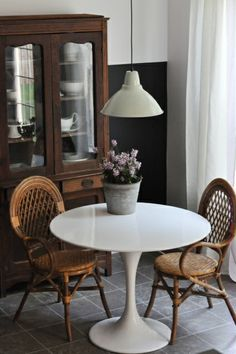 modern / vintage dining space like the dark walls with the antique wood and white table