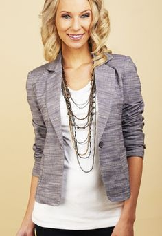 Two-tone blazer with layered necklace
