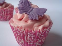 Pretty pink cupcakes with a sparkly purple butterfly and beautiful wrapper Flower Cupcakes, Pink Cupcakes, Just Over The Top, Vanilla Bean Cupcakes, Purple Butterfly, Vanilla Flavoring, Buttercream Frosting, Swirls, Pretty In Pink