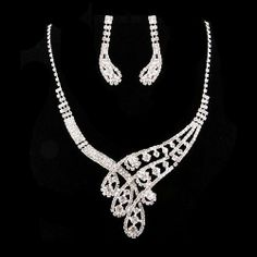 """Bridal Wedding Jewelry Set Necklace Earring Crystal Rhinestone Classic Silver Accessoriesforever. $41.35. Material: Clear Crystal Rhinestones, Metal Casting, Rhodium Plated. Nickel / Lead Free. Dimensions: Necklace: 14"""" Long + 5.5"""" extension (Lobster Claw Closure); Earrings: Approx. 1.75"""" Drop x 0.5""""W (Post Back Closure). Color: Silver, Clear. Style: Curl V-Drop Crystal Earrings, Crystal Rhinestone, Wedding Jewelry Sets, Metal Casting, Clear Crystal, Lead Free, Necklace Set, Bridal, Crystals"""