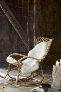 Relax by the fireplace or in the favorite corner in the living room with this cozy rocking chair.