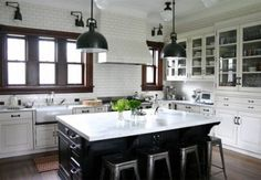 The only picture I've ever seen of natural wood work with white cabinets