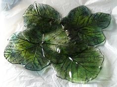 Glassplate made of 5 casted leafs, then tackfused together and then slumped.  Made of 90coe Bullseye art-glass. Aventurine frit & powder, and black opal powder.
