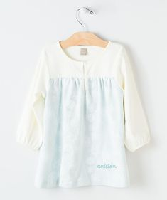This Snowflakes Play Dress is almost an optical illusion with the elegant blue and glowing white pattern intermingling to make a wonderful snowy scene. Created from our softest combed cotton fabric, this long sleeve dress will quickly become your little's favorite to wear whenever they wake up. Choose the personalized option for just a few dollars more to truly make it hers. You can only get this wonderful winter dress online at Hallmark Baby, so order yours now before they're gone for good!
