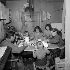 A farm labourer's family eating supper. Scania, southern Sweden, 1946