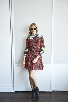 Olivia in Wunderkind sunglasses, a Zara dress, Jimmy Choo shoes and a Whistles belt.