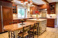 Another beautiful Wood Wise & Remodeling kitchen; KraftMaid island with table attached.